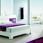 Dormitorio en tonos lilas y blancos